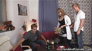 Nasty mom takes two big cocks